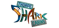 Up to 25% off your stay at THORPE SHARK Cabins Logo